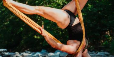 Vacavile Yogi doing aerial yoga and inverted pose