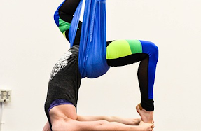 image of inversion pose during aerial yoga