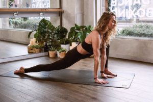 woman doing yoga on the floor