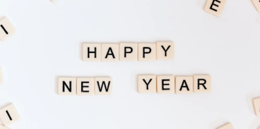 scrabble spelling out Happy New Year