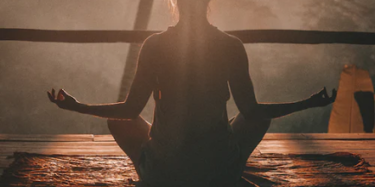 silhouette of a woman sitting in yoga pose during a Vacaville sunset