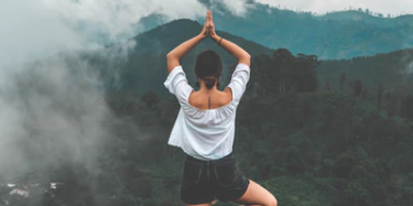 Woman performing yoga pose in the mountains in Vacaville, CA